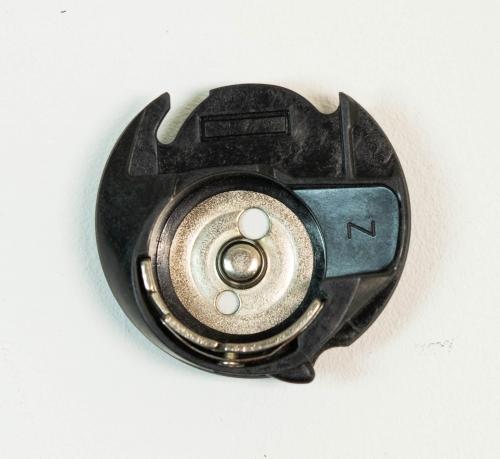 'E' capsula de canilla Singer serie 7400